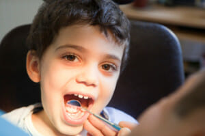 child getting teeth checked by the dentist